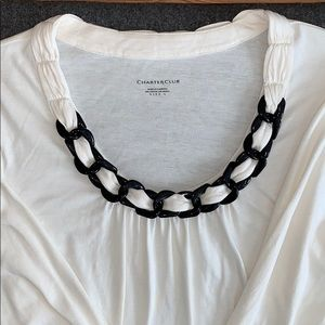 Ivory scoop neck top with black chain accent